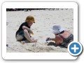 Digging in the sand with mommy.