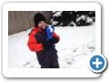Making snowballs.